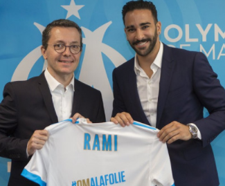 French defender Adil Rami has completed his move to Marseille from Spanish outfit Sevilla, for €6m.