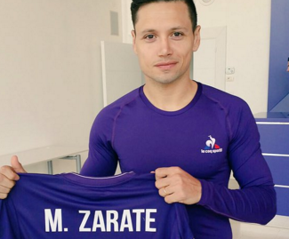 Mauro Zarate has ended his 18-month spell with West Ham by joining Fiorentina on a permanent contract.