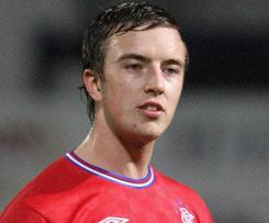 Defender Danny Wilson has penned a three-year deal with Liverpool from Rangers after passing his medical.
