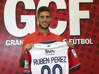 Atletico Madrid have confirmed the transfer of Sevillan midfielder Ruben Perez to Granada.