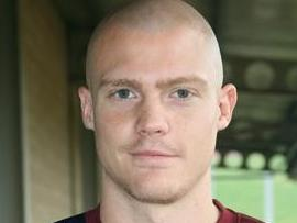Lincoln City signed centre-half Watts, until the summer of 2012