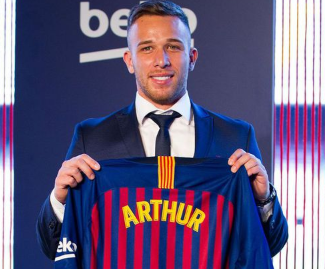 Barcelona have signed midfielder Arthur from Brazilian side Gremio in a deal worth 40m euros.