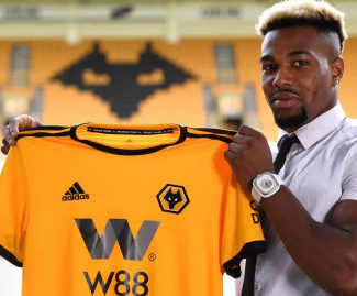 Wolves have signed Spanish winger Adama Traore for a club record fee after meeting the £18m release clause in his Middlesbrough contract.