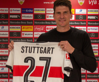 Mario Gomez has rejoined former club Stuttgart from Bundesliga rivals Wolfsburg.