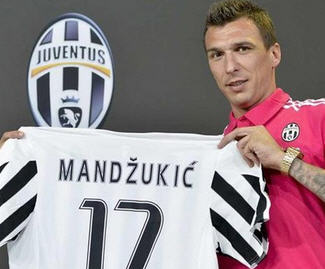 Juventus have completed a deal to sign Atletico Madrid striker Mario Mandzukic.