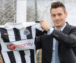 Lille defender Mathieu Debuchy has completed his £5.5million move to Newcastle.