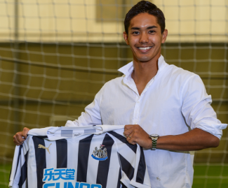 Yoshinori Muto has completed a move to Newcastle United from FSV Mainz signing an initial four-year contract at St. James' Park.