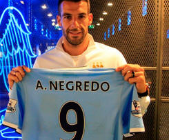 Manchester City have completed the signing of Spain international Alvaro Negredo for £20m from Sevilla.