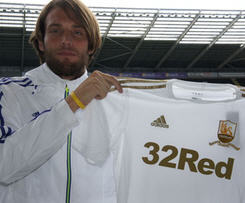Swansea City have completed the deal to sign Michu as the Spanish midfielder has agreed a three-year contract.