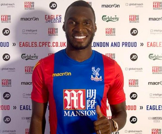 Crystal Palace have signed Belgium international striker Christian Benteke from Liverpool on a four year contract.