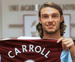 West Ham United have completed the signing of England striker Andy Carroll from Liverpool for a club record £15m.