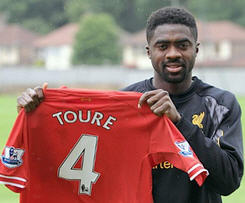 Liverpool sign defender Kolo Toure on a free from Manchester City.