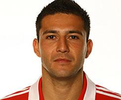 Wigan have completed the signing of Paraguay international Antolin Alcaraz after the defender was granted a work permit.