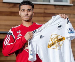 Swansea City completed the signing of Tottenham full back Kyle Naughton on a three-and-a-half-year contract.