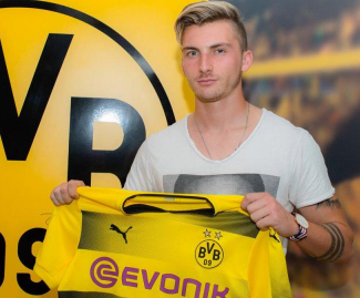 Borussia Dortmund have signed Germany Under-21 international midfielder Maximilian Philipp from Freiburg for a reported €19.5 million fee.