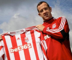 Stoke City have completed the signing of Liverpool star Charlie Adam.