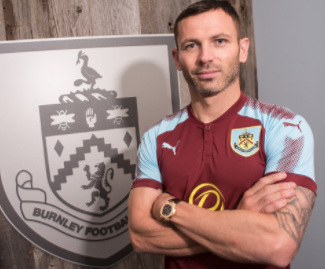 Burnley have completed the signing of full-back Phil Bardsley from Stoke City on a two-year deal.