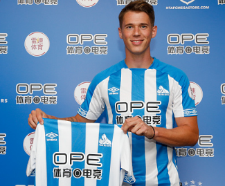 Huddersfield have confirmed the signing of Germany international defender Erik Durm from Borussia Dortmund for an undisclosed fee.