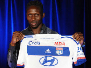 France defender Mapou Yanga-Mbiwa has completed his transfer from AS Roma to Lyon after signing a five-year deal with the French league club.