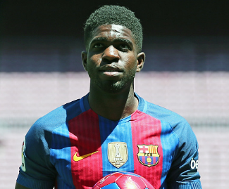 Barcelona have completed the signing of France centre-back Samuel Umtiti from Lyon.