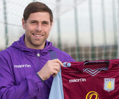 Grant Holt has signed for Aston Villa from Championship side Wigan on a loan deal until the end of the season.