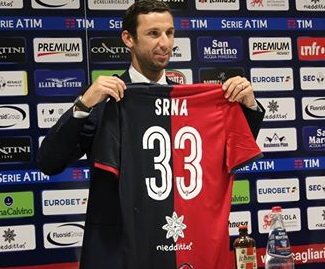 Cagliari have confirmed the signing of former Croatia captain Darijo Srna, who is serving a suspension for doping.