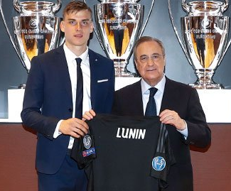 Real Madrid have confirmed the signing of goalkeeper Andriy Lunin, 19, from Zorya Luhansk for a reported initial fee of €8.5 million.