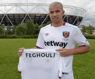 The Algeria winger Sofian Feghouli has signed for West Ham United on a free transfer from Valencia.