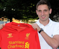 Liverpool have completed the signing of Swansea's Wales international midfielder Joe Allen.