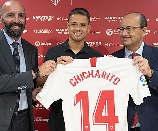 Sevilla have signed striker Javier Hernandez on a three-year deal from West Ham United.