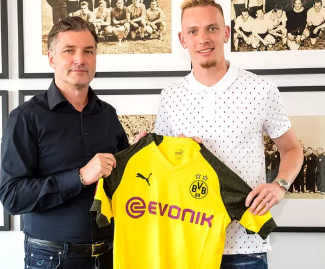 Borussia Dortmund have completed the signing of highly rated attacking midfielder Marius Wolf from Eintracht Frankfurt.