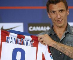 Atletico Madrid have signed striker Mario Mandzukic from German champions Bayern Munich.