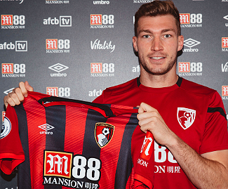 Bournemouth have signed defender Jack Stacey from Luton Town for £4m on a four-year deal.
