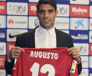 Atlético Madrid have got the January transfer window under way in Spain by signing the Argentinian international midfielder Augusto Fernández from Celta Vigo.