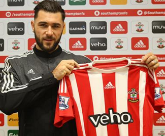 Southampton have completed the signing of Charlie Austin from QPR on a four-and-a-half-year contract.