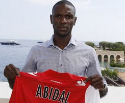 Former Barcelona defender Eric Abidal has rejoined his first professional club Monaco on a three-year contract.