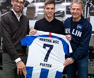Hertha Berlin have signed Poland international forward Krzysztof Piatek from AC Milan for a reported 27 million euros.