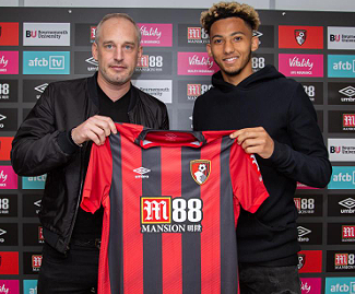 Bournemouth have signed England Under-21 defender Lloyd Kelly from Bristol City for £13m.