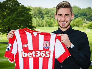 Real Madrid youngster Sergio Molina signs for Stoke City on three-year contract.