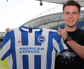 Celtic kid Josh Kerr has completed his stunning switch to Premier League newboys Brighton.
