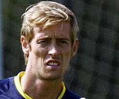 Peter Crouch has completed a £10m move to Stoke