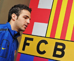 Cesc Fabregas has completed his move to Camp Nou from Arsenal by signing a five-year contract.