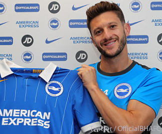 Brighton have completed the signing of midfielder Adam Lallana from Liverpool on a free transfer.
