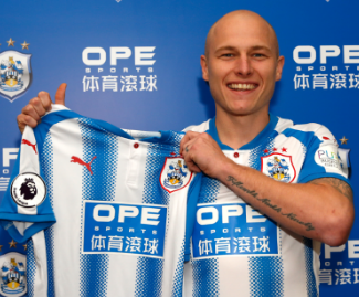 Huddersfield have signed Aaron Mooy from Manchester City in a club record deal that could rise up to £10m.