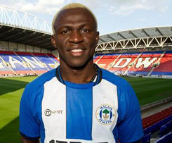 Wigan have completed the signing of Ivory Coast striker Arouna Kone from La Liga side Levante.