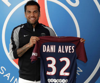 Dani Alves signs for Paris Saint-Germain on a two-year deal after turning down Manchester City.