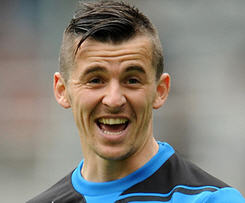 Joey Barton has completed his move to QPR from Newcastle, signing a four-year contract