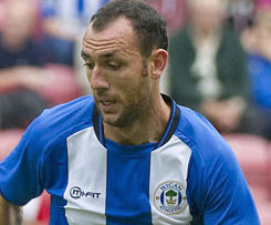 Wigan have beaten West Ham to the signing of Real Mallorca defender Ivan Ramis for an undisclosed fee.