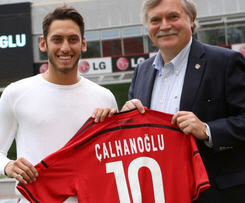 Hakan Calhanoglu has completed his move from Hamburg to Bayer Leverkusen, bringing a long-running transfer saga to an end.