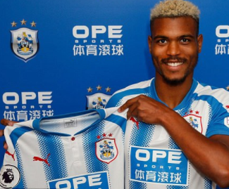 Huddersfield Town sign striker Steve Mounie from Montpellier for a club-record fee.